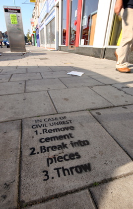 London cement stencil offer advice for civil unrest.